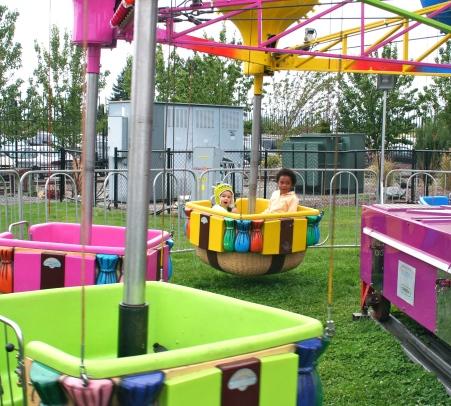 Grace enjoys a ride at the fair