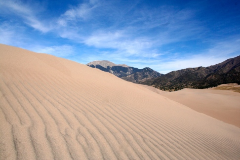 A cool view of the wind-blown sand and surrounding mountains