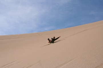 The best part about hiking up the dunes is sliding back down!