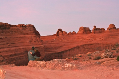 Andrew and I took a break as the sun set over Delicate Arch in Arches National Park