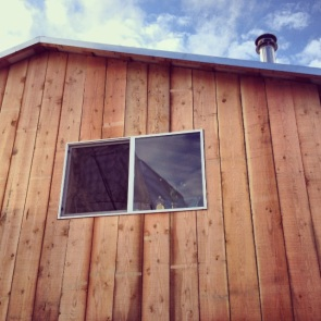 Andrew is almost done siding the tiny house. Now we just need to insulate the floors, hang some wool blankets over the windows, plumb the hot water, and get some good firewood and we'll be ready for winter. Probably just in time for spring.