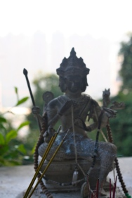 A statue with incense offerings