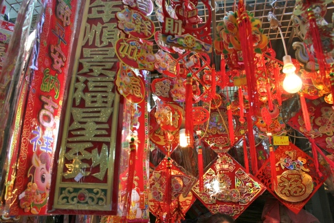 One of the booths in the street market, offering Chinese New Year trinkets.