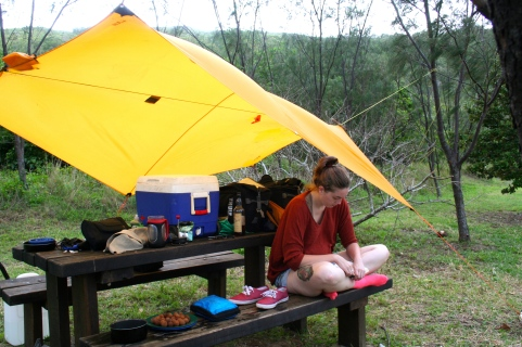 Cathy reads under our tarp. This is what most of our camping trip in the Whitsundays looked like