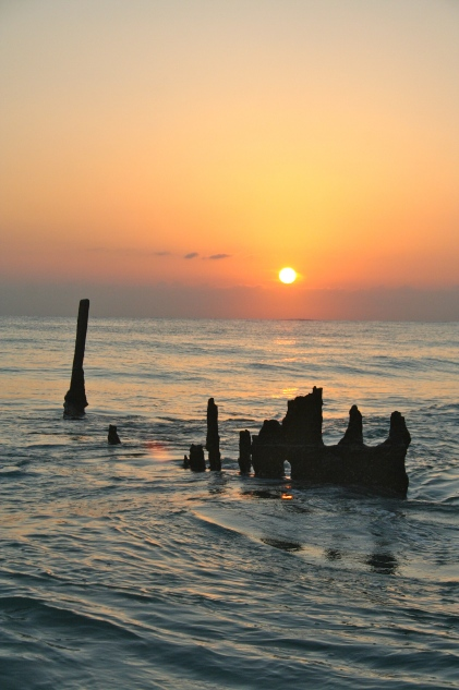 Andrew took amazing photos of the sunrise over Dicky shipwreck at Dicky Beach.