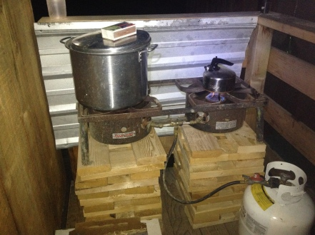 This here's our summer stove, out on the porch! It's a little intense for a teapot but it sure is fun cooking outside!
